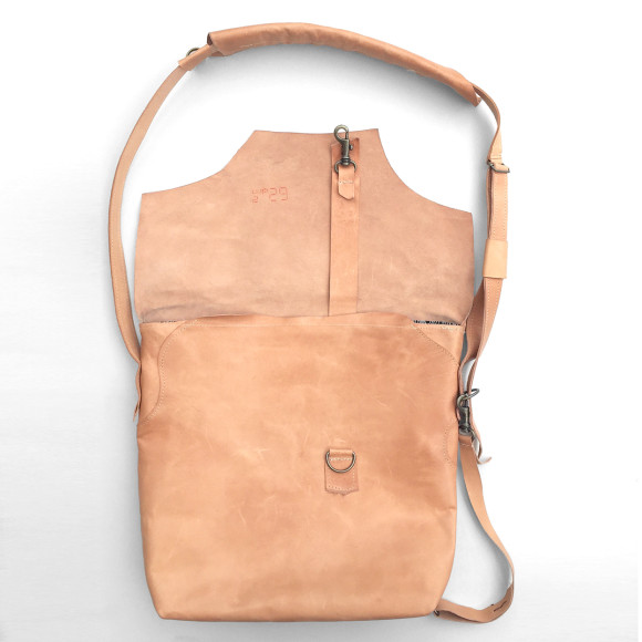 Flip lid with durable brass closure and Extra strap for securing bag while walking or cycling