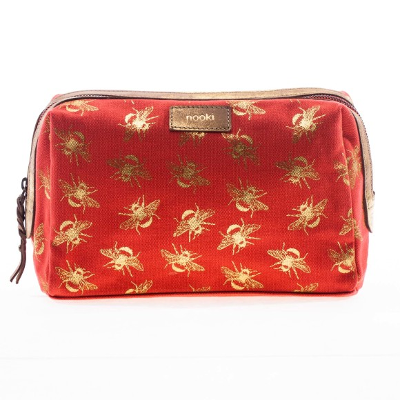 Suki wash bag front shot in coral