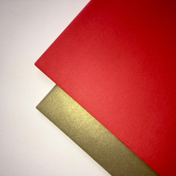 Metallic Gold and Christmas red large envelopes.