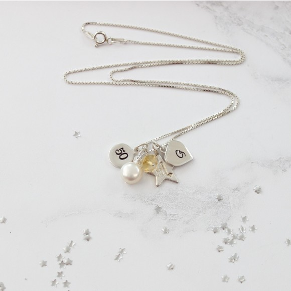 50th birthday necklace personalised with letter and zodiac charms and citrine birthstone for November