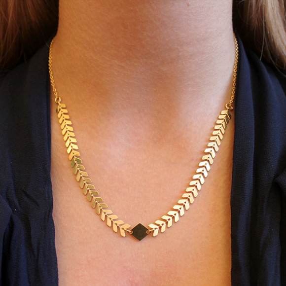 Model wearing andromeda necklace gold