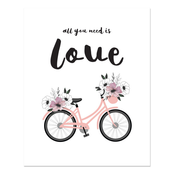 Bicycle with all you need is love text