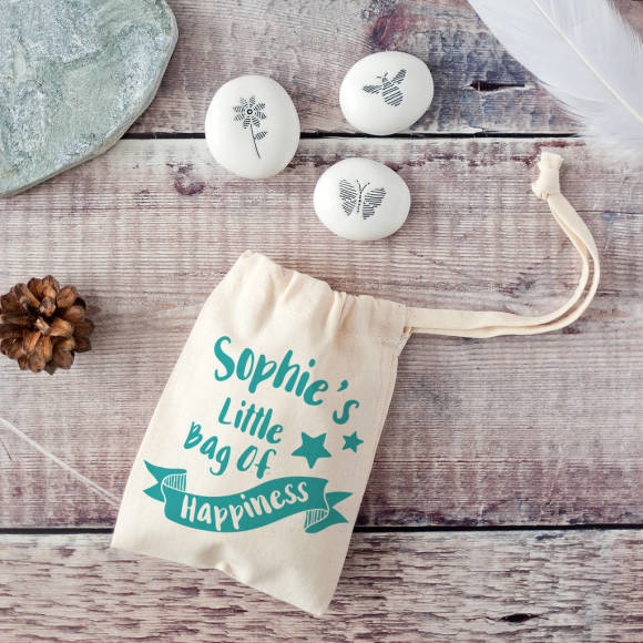 teal bag showing front of pebbles