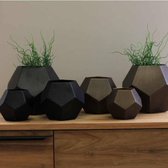 Black and Copper colored vases together