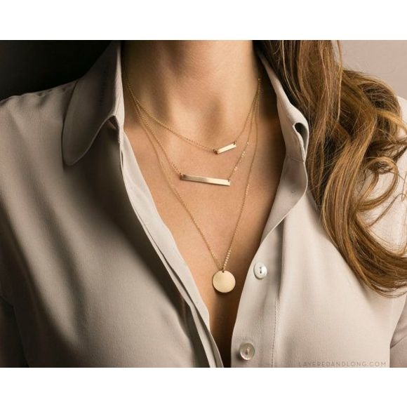Customer photo wearing the bar layered with our other necklaces