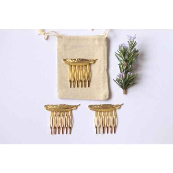 Delicate gold feather hair combs