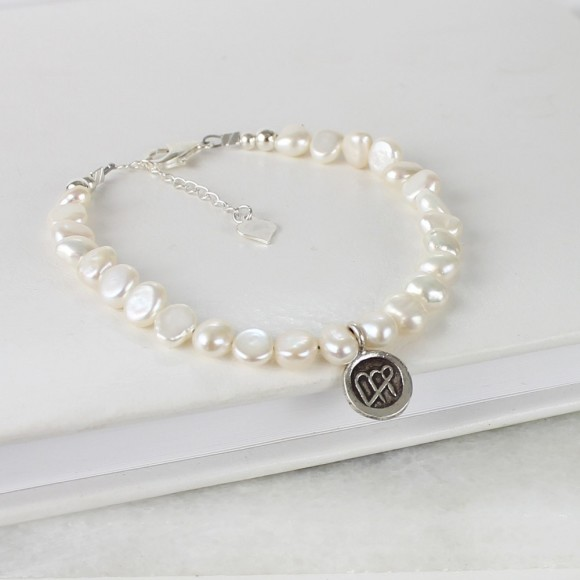 pearl bracelet with virgo charm