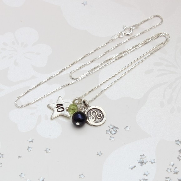 40th birthday necklace personalised with peridot and leo zodiac round disc charm for August birthdays