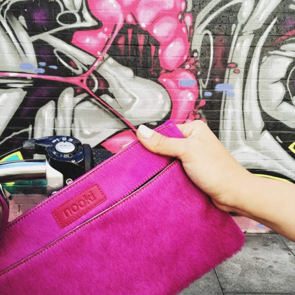 Luxe clutch fuchsia lifestyle shot