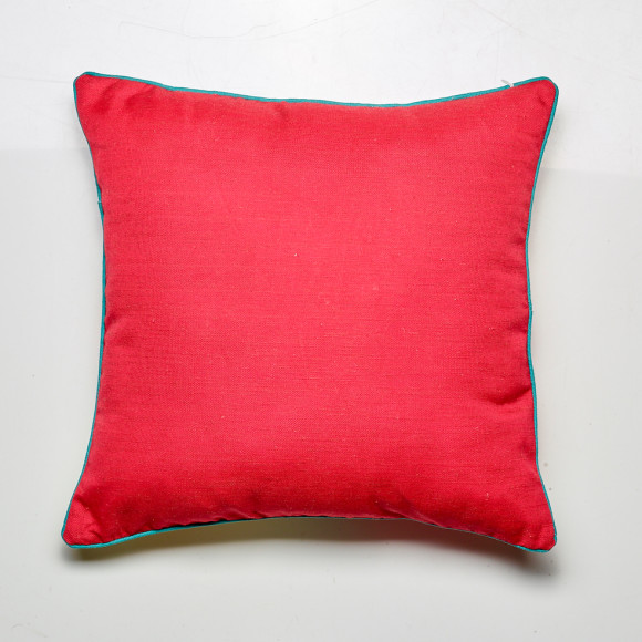 Reverse of the Peacock cushion in red