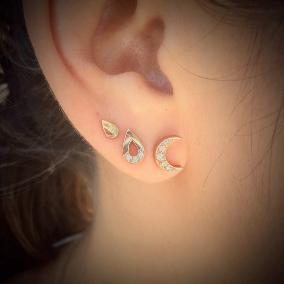 this picture is set with diamonds but displays the size of the moon stud this listing for plain studs only