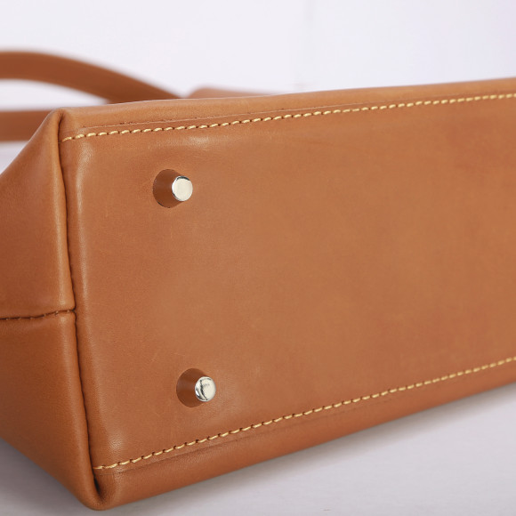 bottom of leather tote with protective buttons
