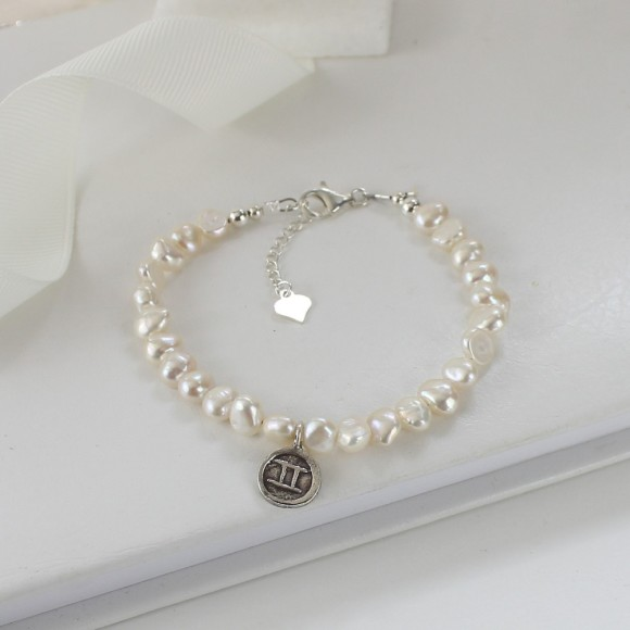 Pearl bracelet with sterling silver gemini charm