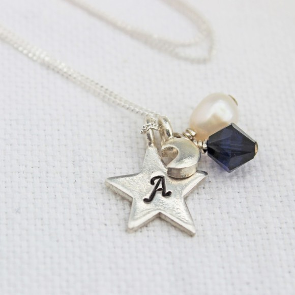 personalised reach for the moon charm necklace, jewellery to inspire