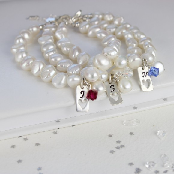 personalised pearl bracelet love tag and fuchsia, crystal ab and sapphire blue crystals