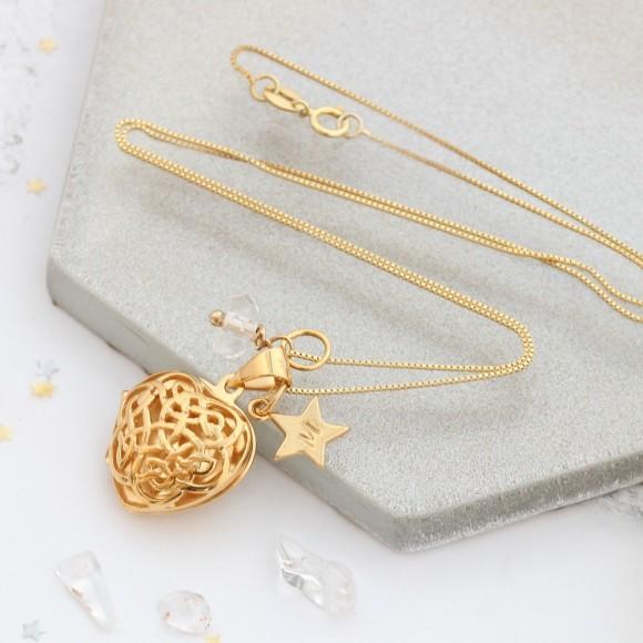 gold filigree heart locket with April birthstone