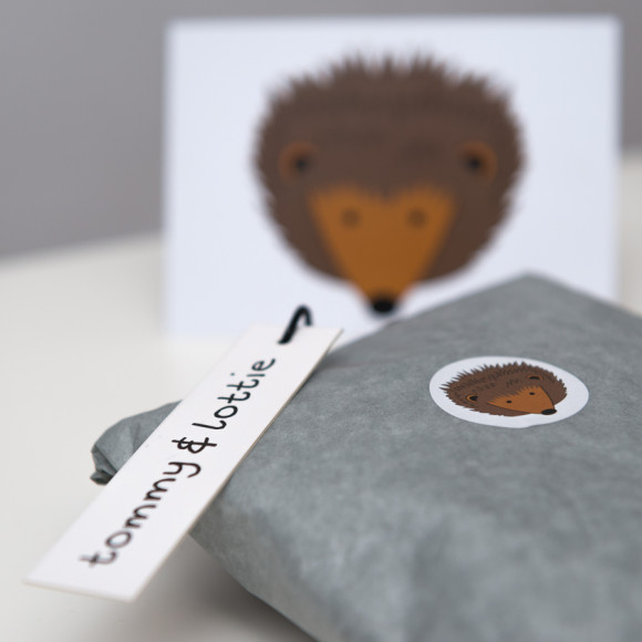 Free hedgehog postcard and tissue wrapped with little stickers