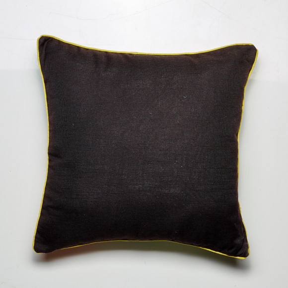 Reverse of the Peacock cushion in black