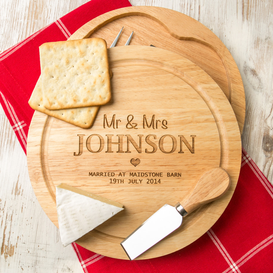 Personalised wedding cheese board and knives set hardtofind.