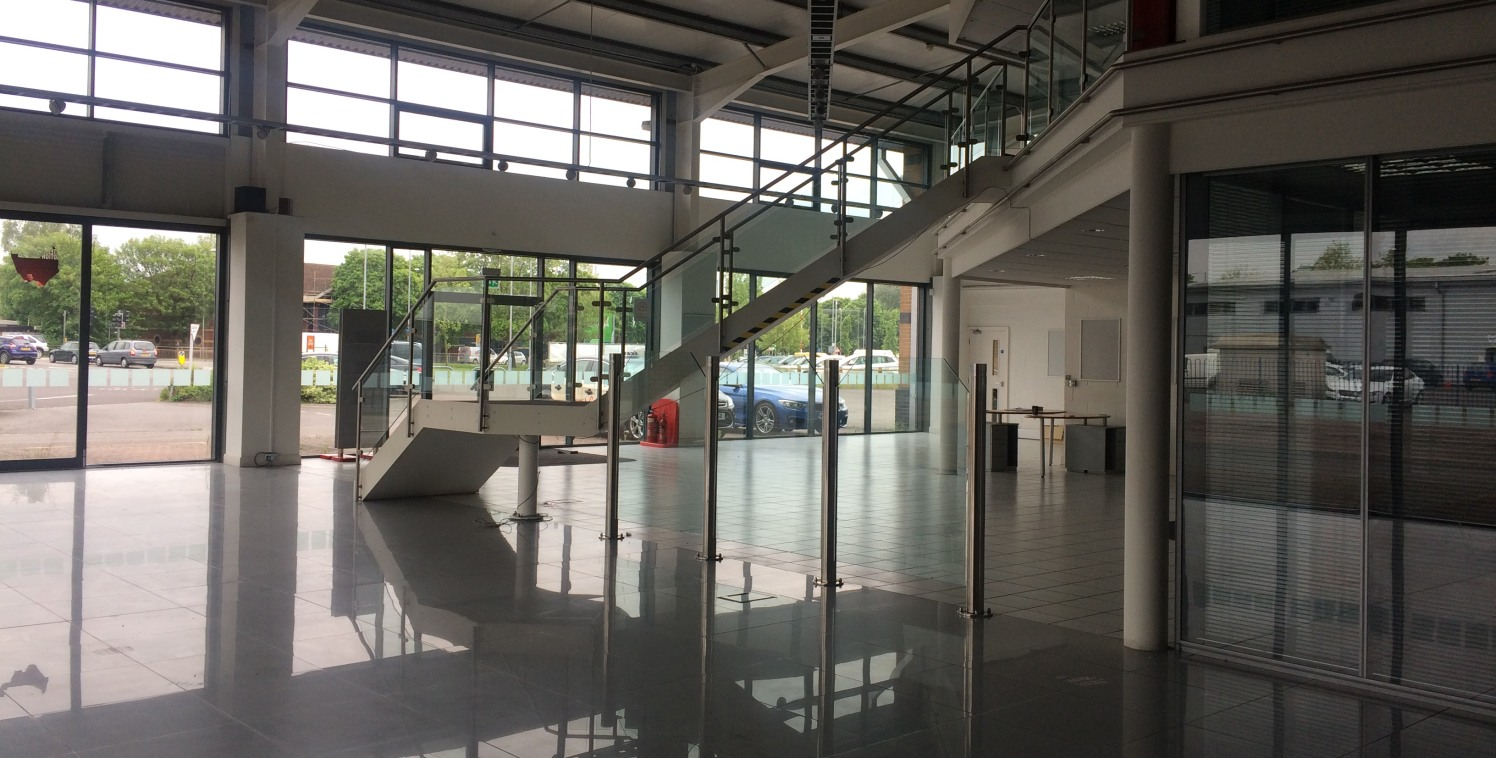 A purpose built vehicle showroom originally  occupied as a Mitsubishi motor dealership. The  building comprises a steel frame structure with part  glazed and part brick/clad elevations.  Internally the accommodation is arranged with a  glazed, double...