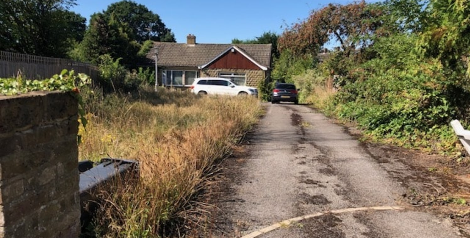 The plot is positioned on Bells Hill directly opposite a bus stop, within walking distance of the village centre which has various amenities such as a pharmacy, Costa Coffee, Co-Op and Doctors Surgery. The plot currently consists of a detached bungal...