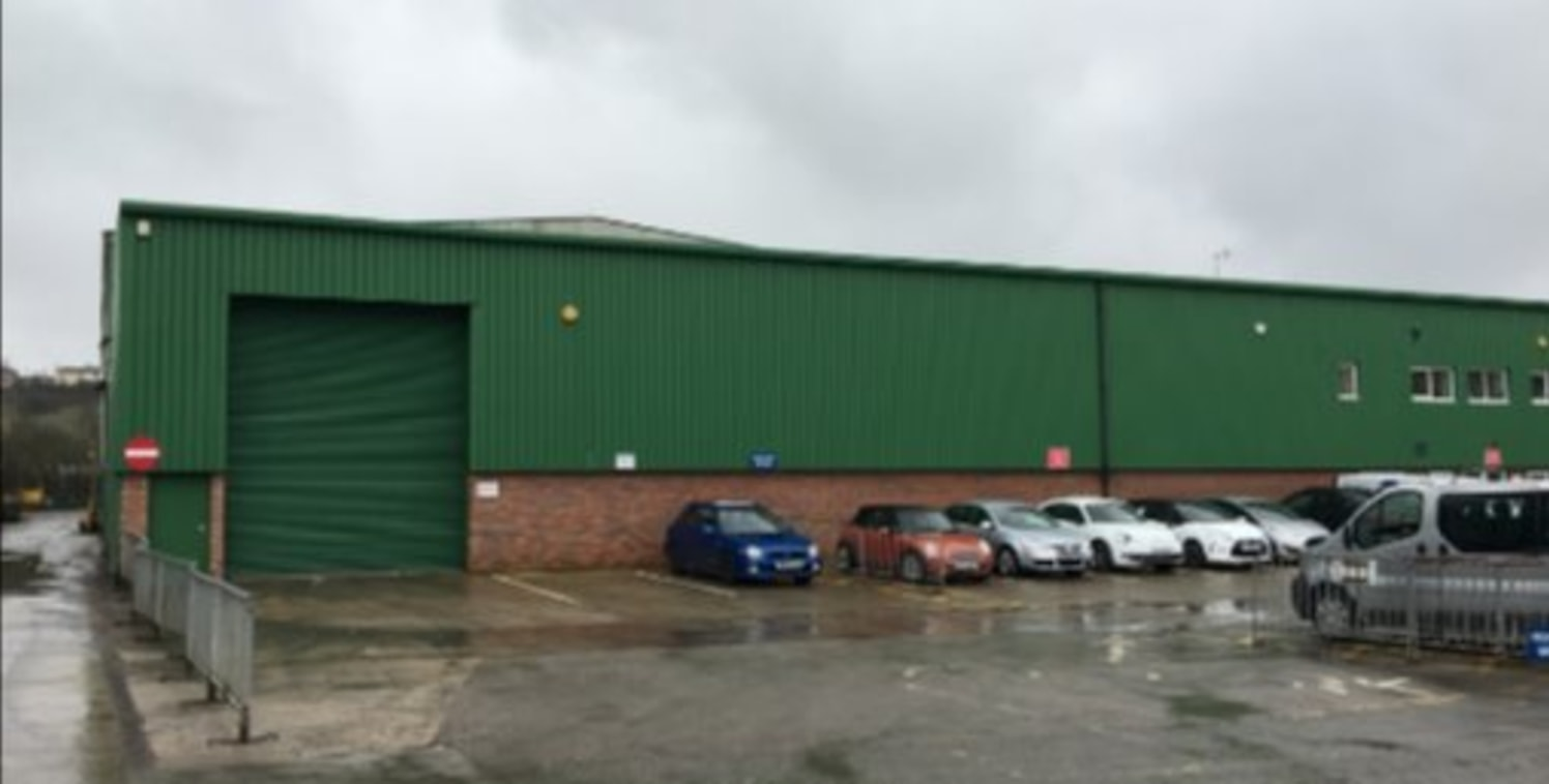 The subject property comprises a substantial detached high bay warehousing premises of steel portal frame construction set beneath a pitched and profile clad roof covering. Internally, the unit provides for open plan L shaped warehousing with an eave...