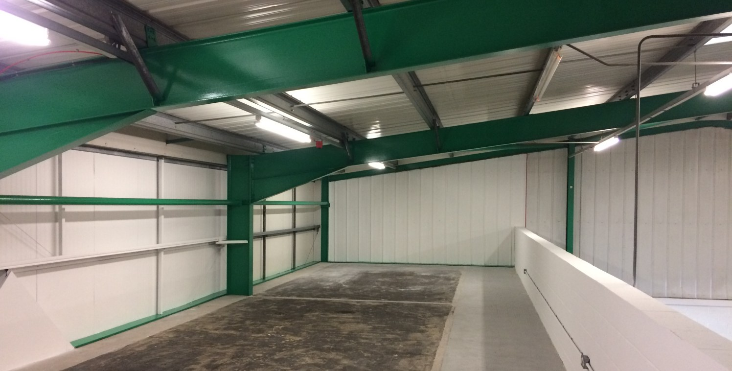 The property comprises a semi-detached industrial unit of steel portal frame construction with insulated metal clad walls. The roof is also covered in insulted metal clad panel.  There is office and cavity space to the front of the unit. Amenities in...