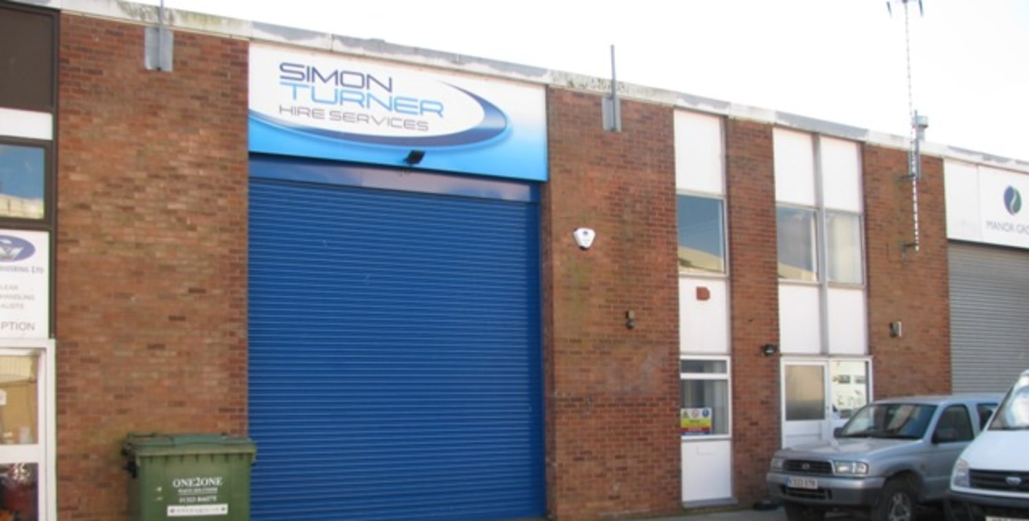 Comprises a mid terraced 1970's industrial unit of steel portal frame construction with brick block elevations. The accommodation offers ground floor, warehouse/factory with electric roller shutter door, WCs and gas blow heater. Please note gas is no...