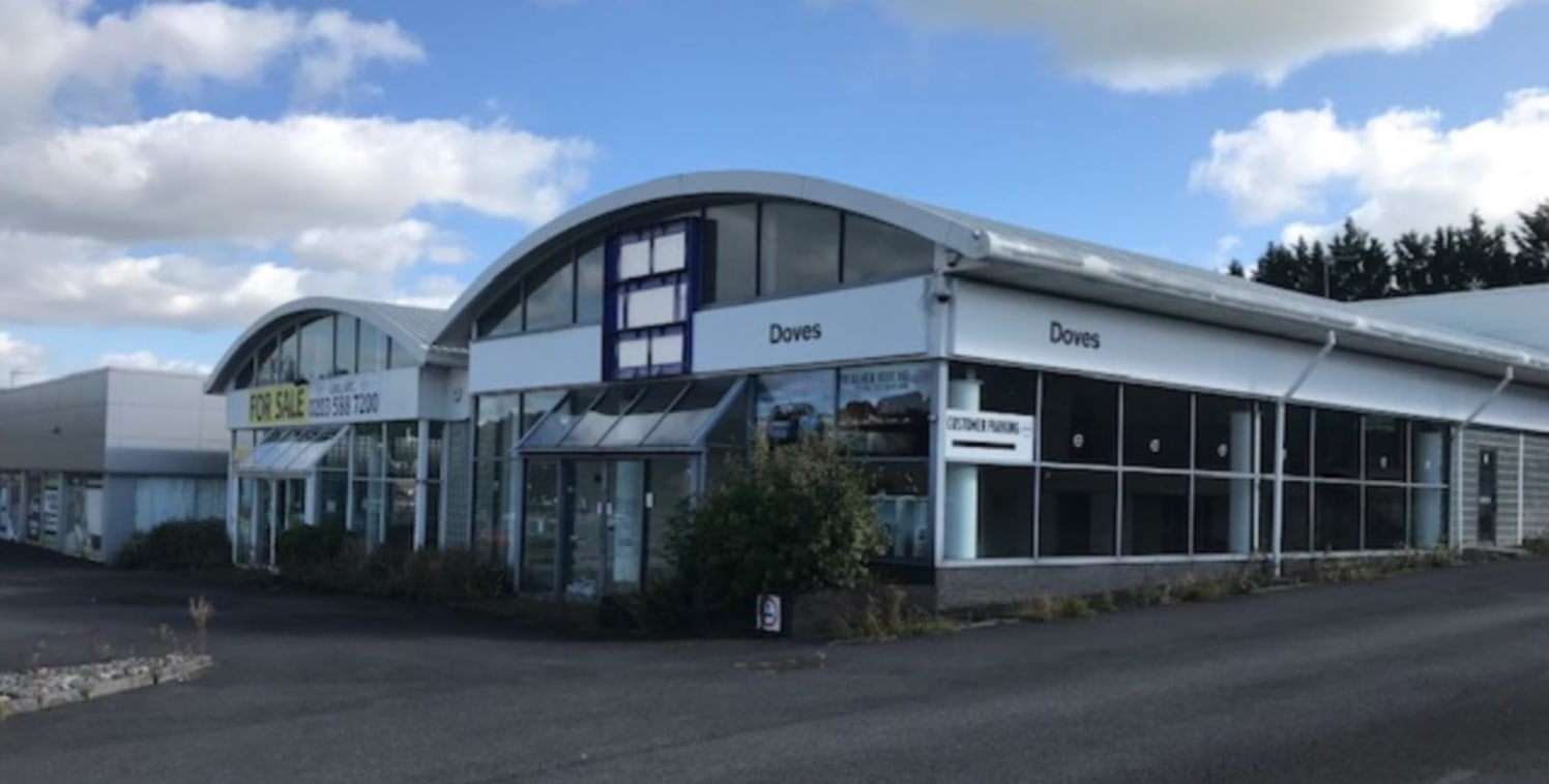 The property comprises a purpose built motor dealership constructed in the mid 1990's.<br><br>The property was previously occupied by Renault and Volvo. It has the benefit of two large retail showrooms and two individual workshops to the rear with of...