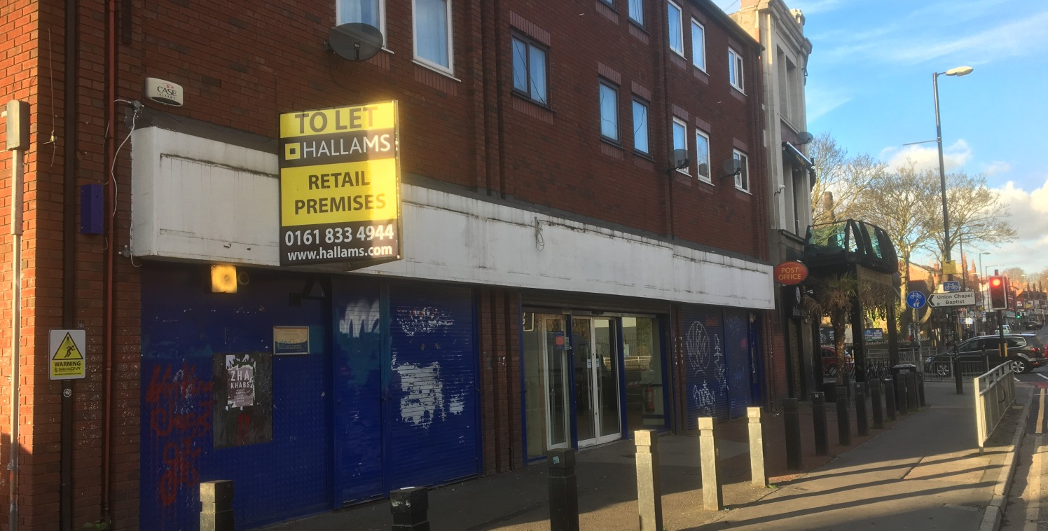 LOCATION  Located on Wilmslow Road, the subject property occupies a prominent roadside position within the popular student suburb, Fallowfield.  The unit is positioned opposing The University of Manchester's Fallowfield Campus and the popular Sainsbu...