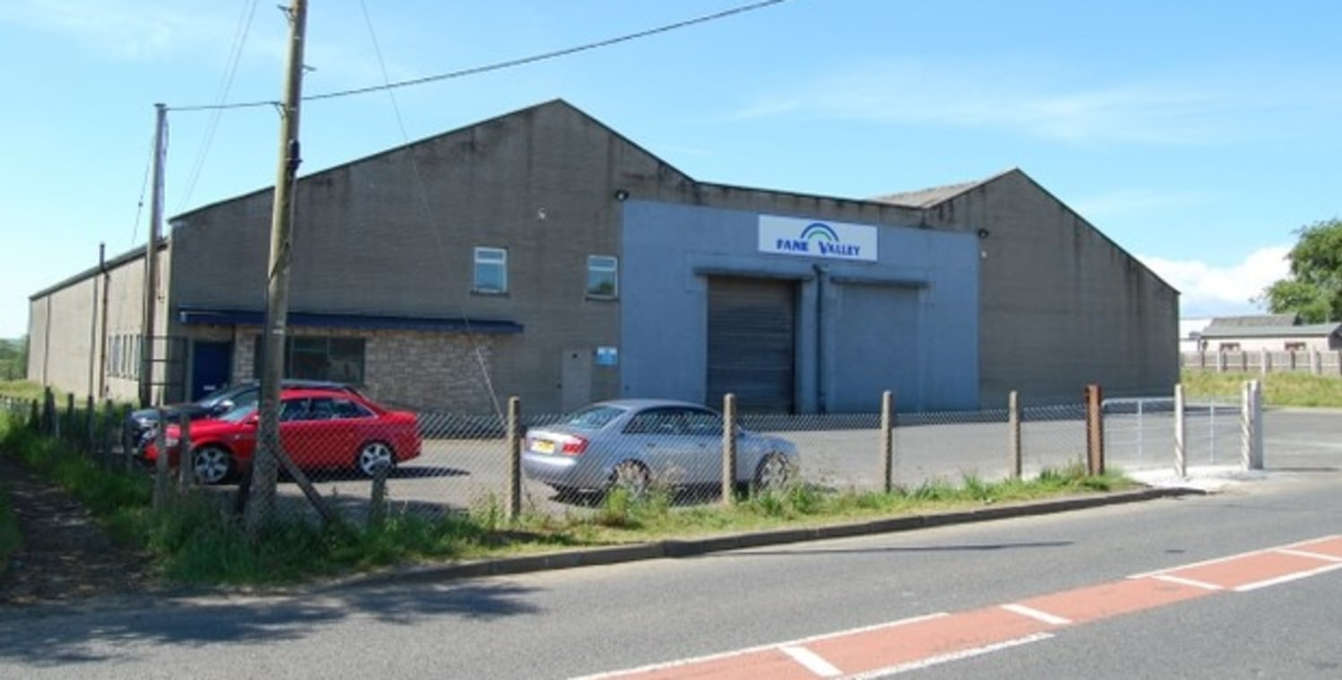 EXTENSIVE PRODUCTION/WAREHOUSE PREMISES SET IN SELF CONTAINED YARD\n\nThe premises are situated on the western side of Dervock Village fronting the B66 approximately 3 miles from the A26 Ballymoney Bypass and 4 miles from the town itself.\n\nEssentia...