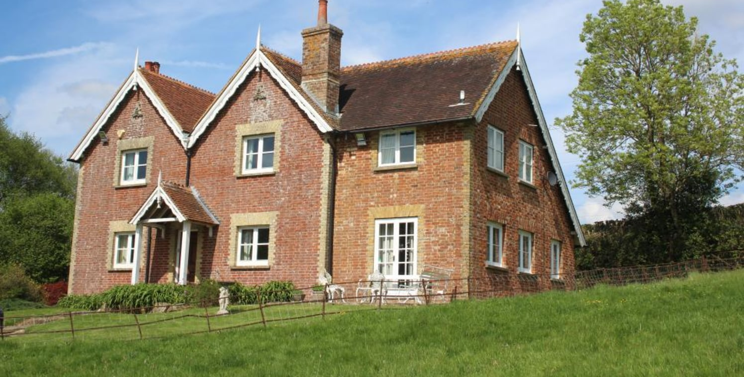 A residential and grassland farm with a detached Victorian farmhouse overlooking fields and lakes, set within approximately 34.5 acres. Further land available by separate negotiation.