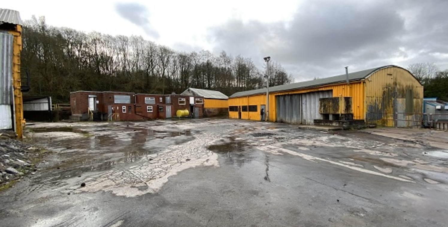 The subject property comprises of several industrial units and office accommodation, set up on an extensive site, which covers circa 2 acres. Several of the buildings upon the site are of timber frame construction, set beneath varying roof types.  Fu...