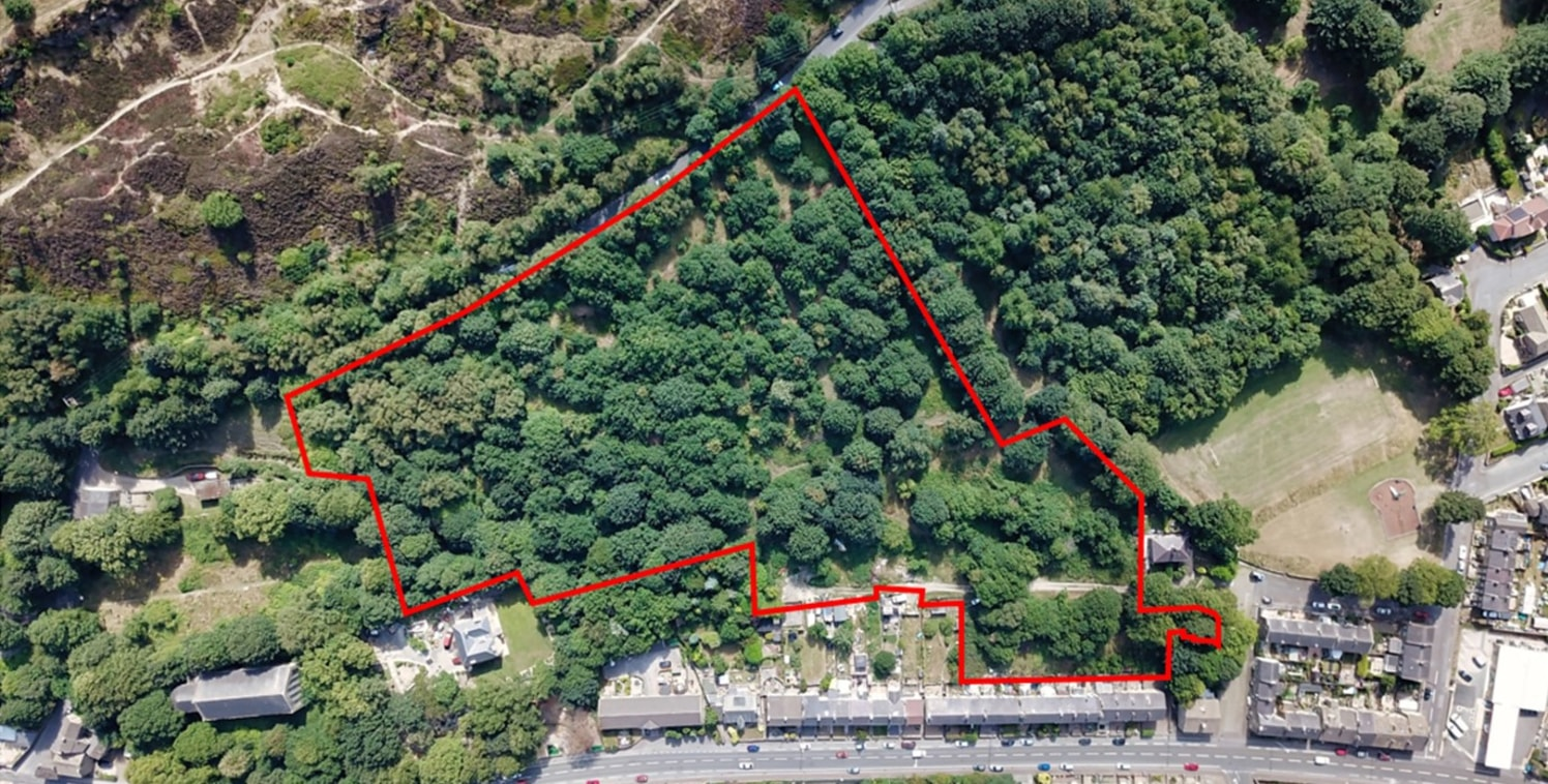 The site comprises 6.35 acres of sloping woodland, nestled between established housing, fronting Manchester Road to the North, Coronation Park to the west and Deep Lane, which forms the southern boundary. The site takes highway access from Queens Roa...