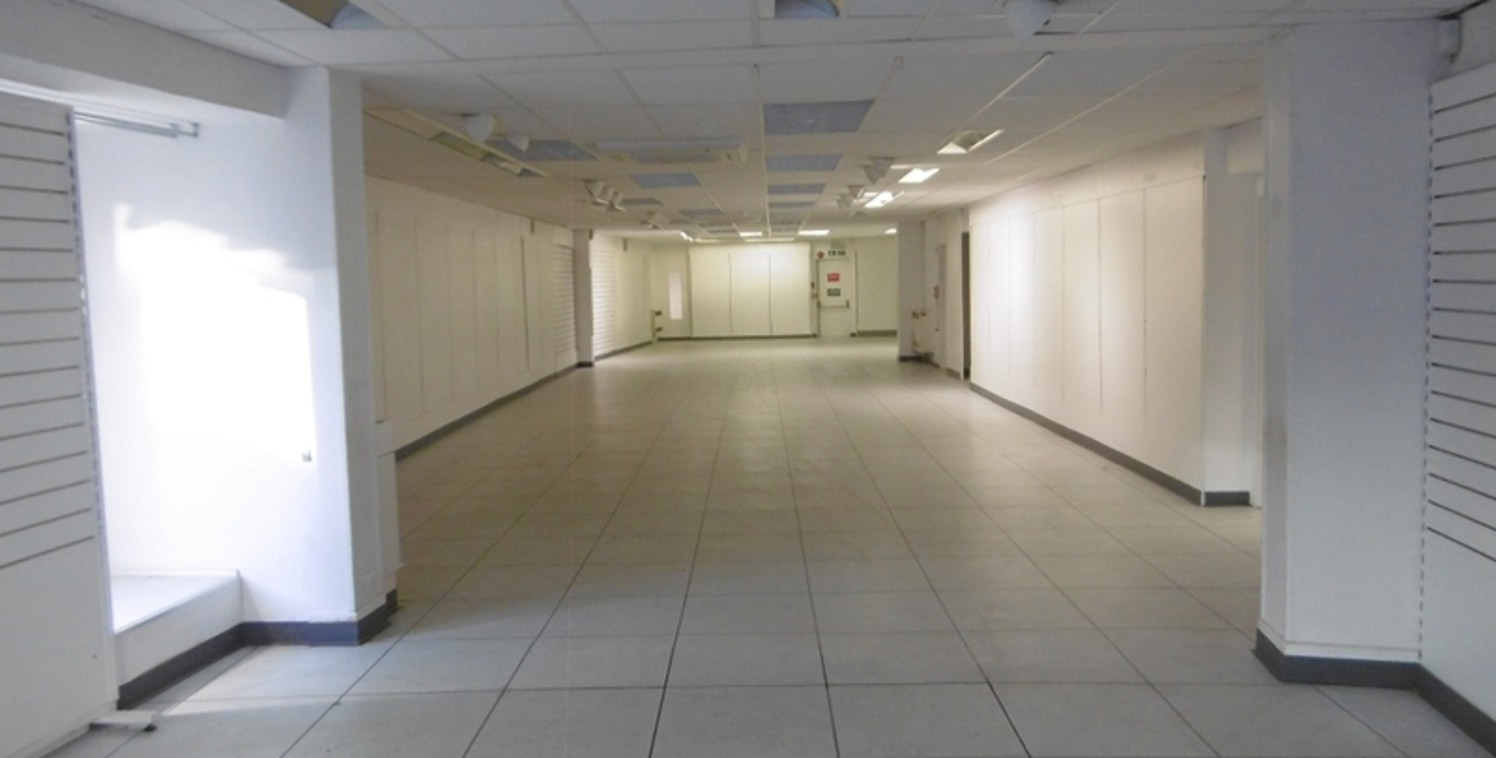 The property provides a large ground floor retail area with ancillary stores above. The unit is fitted with a suspended ceiling and inset lighting with a tiled floor....