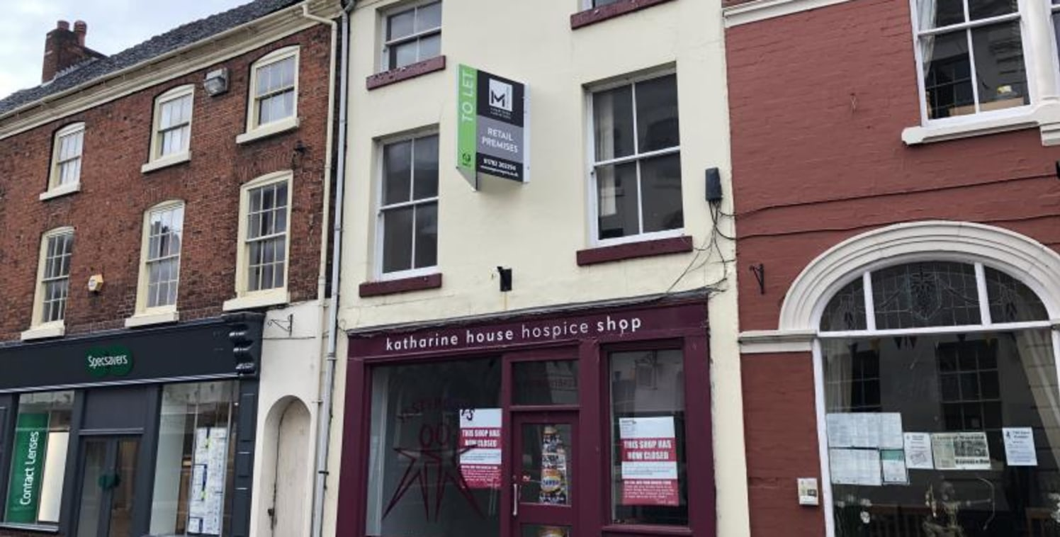 The property is a three storey building with rear single storey extension of concrete panel construction and parking for one vehicle from Christchurch Way.\n\nThe ground floor consists of a front retail/reception area, leading into a larger retail ar...