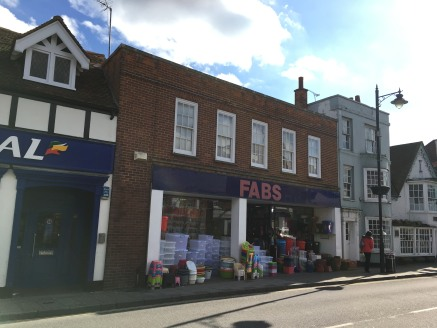 The subject property lies directly opposite the Newland Shopping Centre and close to the junction with Collingwood Road. The property comprises a two storey building beneath a pitched, tiled roof with dormer windows to part and a flat roof.