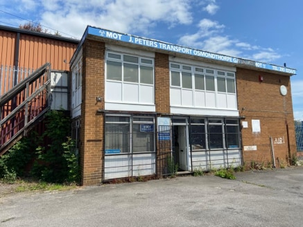 The property comprises a former filling station forecourt with two buildings. The workshop unit is constructed around a concrete frame and has a pitched cement sheet roof, brick/block walls, concrete floor with an inspection pit and rolling road. The...