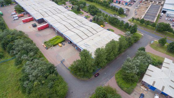 The property comprises a mid terrace industrial unit of steel portal frame construction with brick / block walls to dado level with insulated clad panels above. The roof is pitched with insulated profiled panels with intermittent roof lights.  The pr...