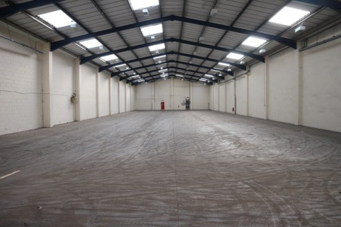 Stadium Trade and Business Park is a modern industrial / warehouse and trade park. The units are of steel portal frame construction with part brick, part steel clad elevations under pitched rooves incorporating translucent roof panels. There is excel...
