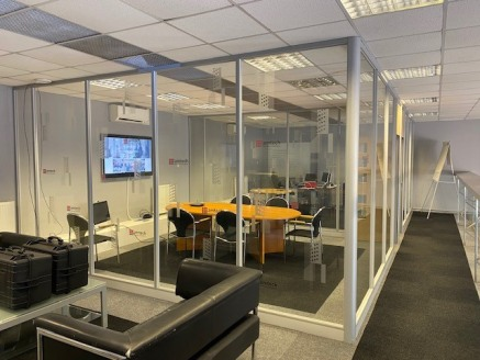 The offices comprise a self-contained building which is largely open plan with useable mezzanine office space and partitioned offices below.  The offices include kitchen, shower and WC facilities, suspended ceiling, ample on-site parking and air cool...