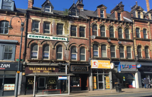 DESCRIPTION\n\nThe property comprises of 4 shop units all of which are planned on ground floor and basement and which are all occupied. Within the main frontage there are two separate entrances to the upper parts which was formerly the Central Hotel....