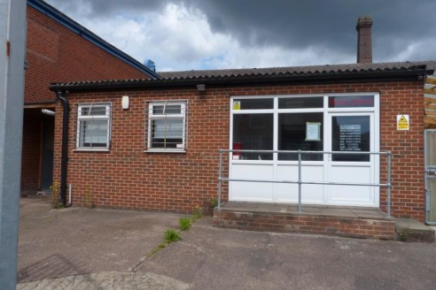 The property comprises an industrial/trade counter unit of traditional brick construction beneath a pitched and clad roof surface. It is situated within a secure, fenced site area and briefly comprises the following characteristics:\n* Trade counter....