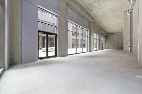 The unit is currently in shell and core, however a basic fit out will be completed by April 2020.  The property finds itself on the ground floor of a large office and residential block and benefits from a large window frontage, allowing plenty of nat...