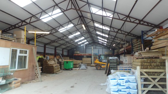 The warehouse space of a little over 3,700 sq.ft. is of steel portal frame construction having a trussed roof under a recently replaced profiled insulated steel-clad roof. It has a good level of natural lighting and a concrete floor as well as an ele...