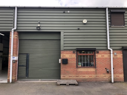 Description   Unit 3 comprises a modern mid-terrace industrial unit of portal-steel frame construction with cavity brick and insulated sheet clad elevations under an insulated sheet clad roof. The unit has a full-size loading door to the front elevat...