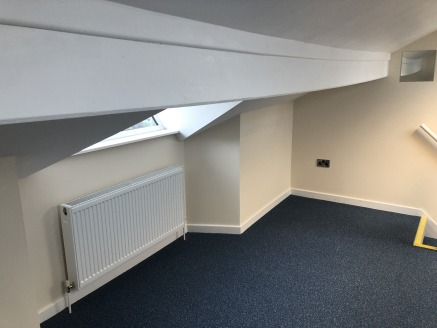 The subject property comprises an end of terraced retail premises, which was formerly the Doffcocker Post Office.  The available accommodation is situated at second floor level and provides a modern, single office room with shared kitchen and WC faci...