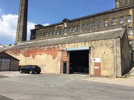 The property briefly comprises modern steel framed and brick clad single storey industrial warehouse/production space that benefits from:  Drive-in access via a full height roller shutter doors;  Solid concrete floor;   Large concrete surfaced shared...