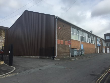 The property briefly comprises a single storey high bay industrial unit with two storey offices and mezzanine level. The unit benefits from:  Solid concrete floor;  Roller shutter access with UPVC framed entrance;  Fluorescent strip lighting;  Gas sp...