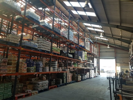 Substantial warehouse with secure yard and excellent eaves  TO LET (11,478 sq ft)